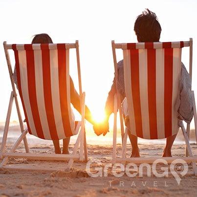Galapagos-Honeymoon-Couple-relaxing-on-beach