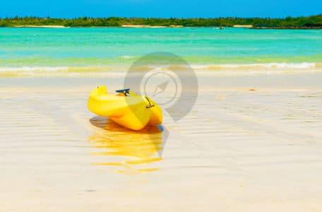 Hawaii-Versus-Galapagos-Kayak-on-beautiful-white-beach