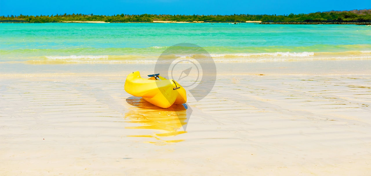 Hawaii-Versus-Galapagos-Kayak-on-beautiful-white-beach
