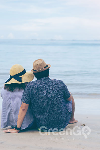 Seaman Galapagos Cruise Honeymoon-Packages-Honeymoon Couple sitting on beach
