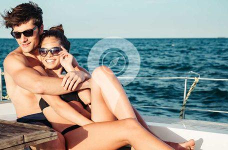 Seaman Galapagos Cruise Honeymoon-Packages-Honeymoon-Couple-Cuddling-On-Deck