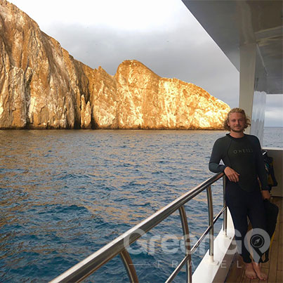 Traveling solo to the Galapagos - Man standing by kicker rock on Grand Queen Beatriz Cruise