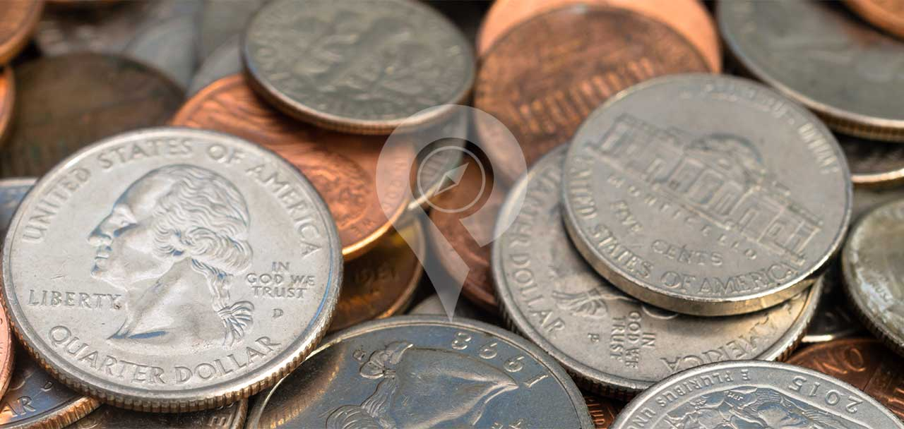 Pile of Coins - Tipping in Galapagos and Ecuador